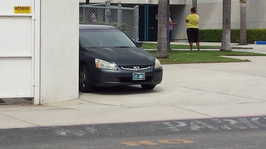 A common sight at Rialto Schools with cars using sidewalks as places to park.