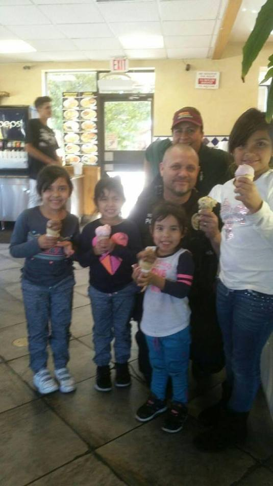 """Sgt. Muir on-duty taking the time to interact with some kids in our community by buying them an ice cream at George's Burger."" Photo Credit Rialto PD Facebook"