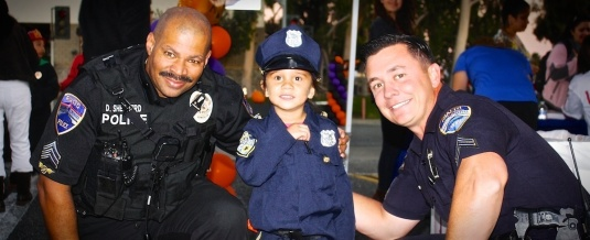 Sargent Nelson posing for a picture at Rialto's National Night Out with Former Traffic Sargent Shepard