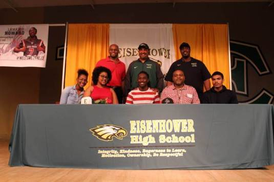 Lamario Howard pictured at his signing celebration with family and coaches. Picture courtesy of RUSD Communications Dept